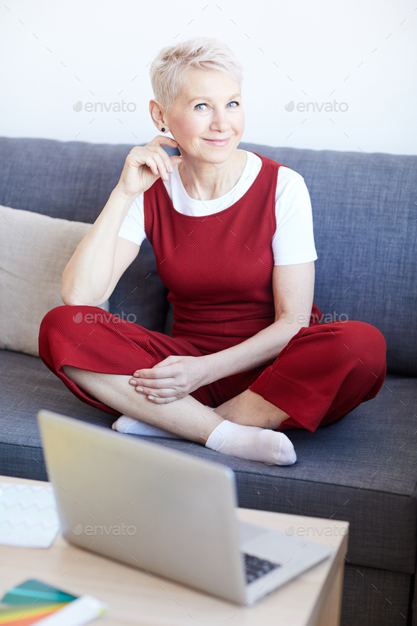 Woman on couch - Stock Photo - Images