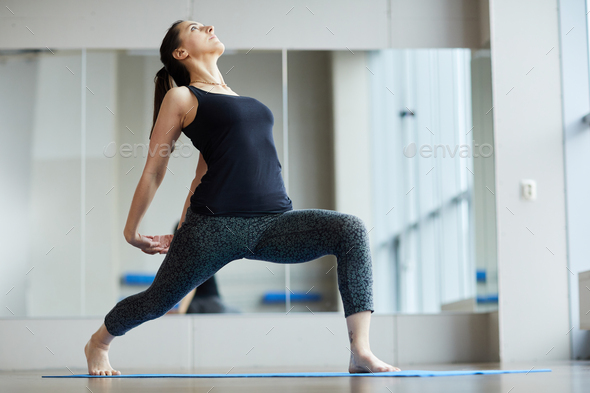 Strengthening back muscles with yoga - Stock Photo - Images