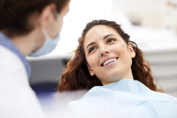 Beautiful Woman in Dentists Chair - Stock Photo - Images