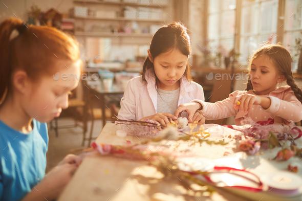 Girls Making Flower Wraths - Stock Photo - Images