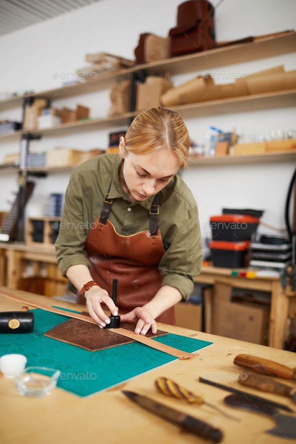 Woman Making Leather Belt - Stock Photo - Images