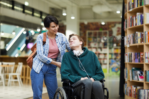 Taking care of disabled student - Stock Photo - Images
