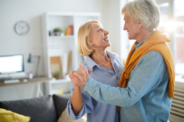 Mature Couple Dancing at Home - Stock Photo - Images