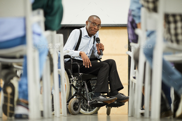 Successful disabled black scientist addressing conference - Stock Photo - Images
