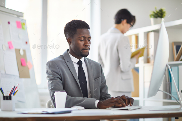 Businessman working in office - Stock Photo - Images