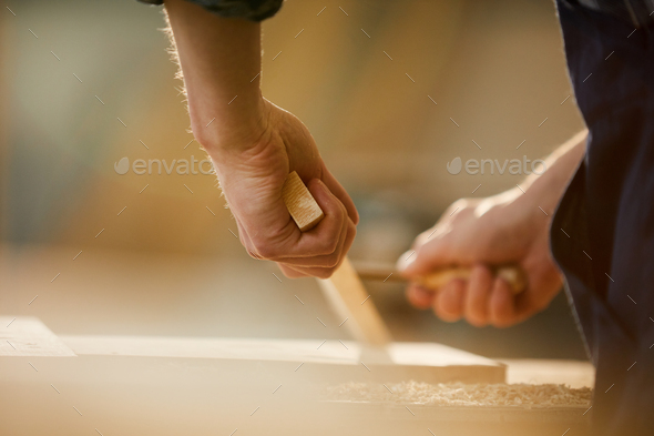 Carpenter Carving Wood - Stock Photo - Images
