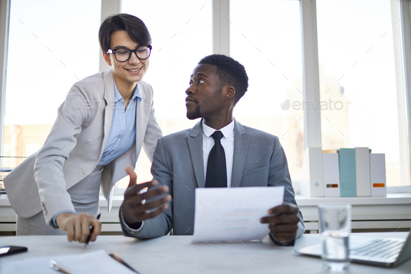 Showing contract to colleague - Stock Photo - Images