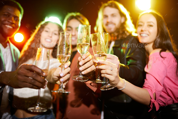 Drinking champagne at party in nightclub - Stock Photo - Images