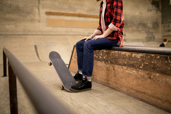 Man Sitting on Ramp - Stock Photo - Images