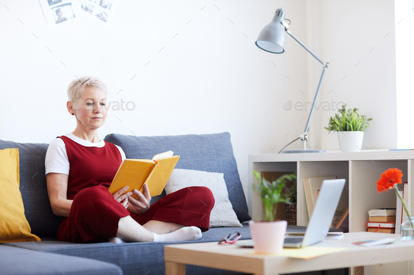 Reading at home - Stock Photo - Images