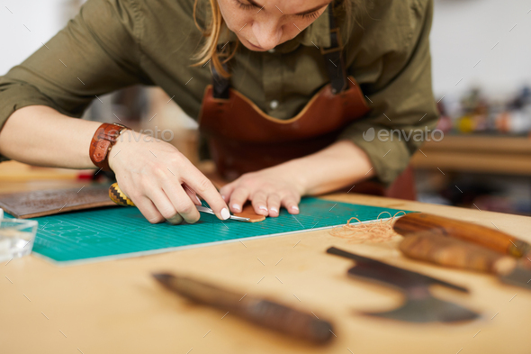 Woman in Leatherworking Shop - Stock Photo - Images