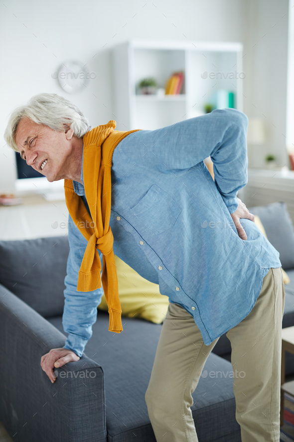 Mature Man Suffering from Back Pain - Stock Photo - Images