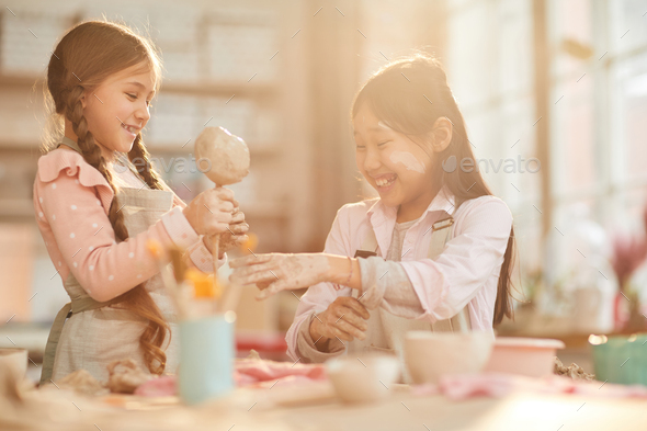 Cute Little Girls in Pottery Studio - Stock Photo - Images