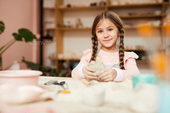 Cute Little Girl doing Potery - Stock Photo - Images