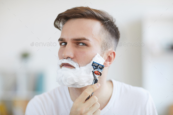 Young Man Shaving - Stock Photo - Images