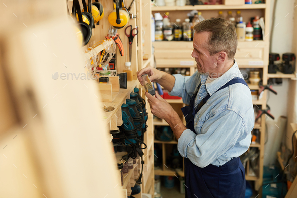 Senior Worker Choosing Tools - Stock Photo - Images
