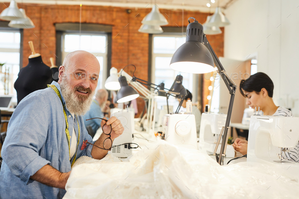 Man sewing clothes - Stock Photo - Images