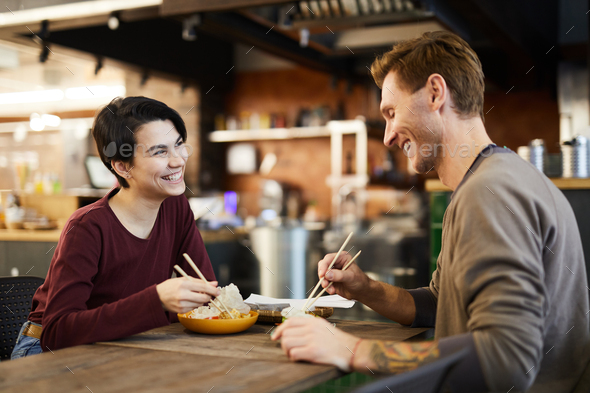 Cheerful Couple in Chinese Food Restaurant - Stock Photo - Images