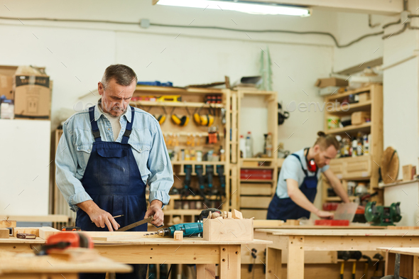 Carpenters Assembling Furniture - Stock Photo - Images