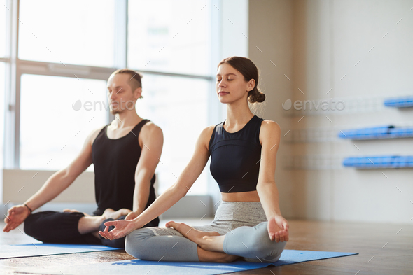 Relaxed couple meditating in silence - Stock Photo - Images