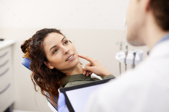 Young Woman Consulting Dentist - Stock Photo - Images