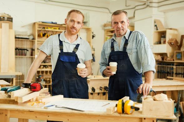 Carpenters Posing at Coffee Break - Stock Photo - Images