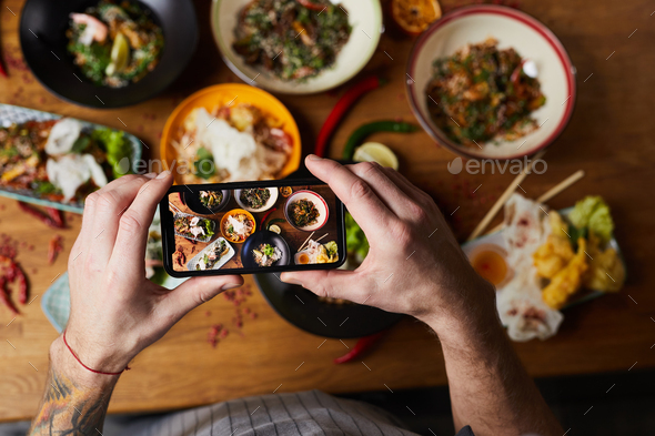 Chef Taking Photo of Asian Food - Stock Photo - Images