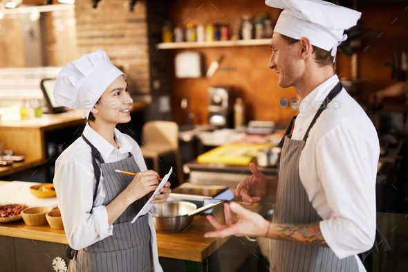 Chefs Discussing Menu - Stock Photo - Images