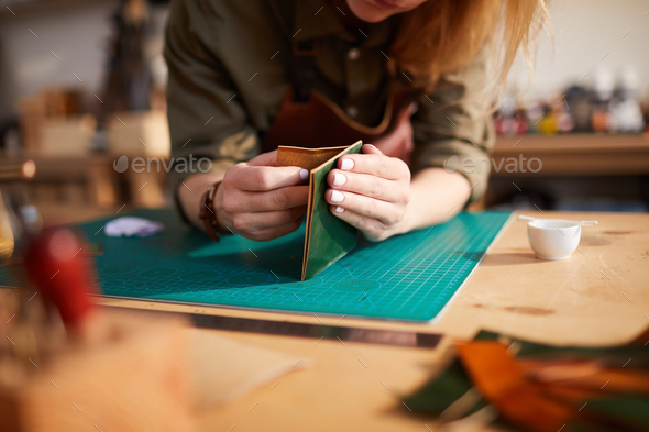 Unrecognizable Woman doing Leatherwork - Stock Photo - Images