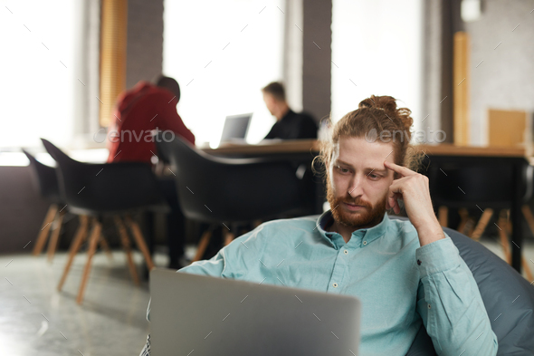 IT Specialist Working in Bean bag - Stock Photo - Images