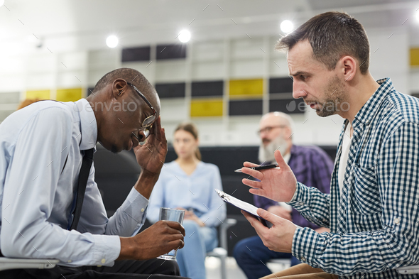 African Man in Mental Health Consultation - Stock Photo - Images