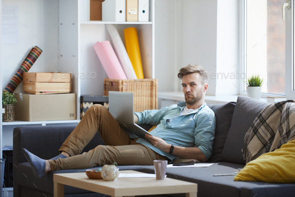 Handsome Man Using Laptop on Sofa - Stock Photo - Images