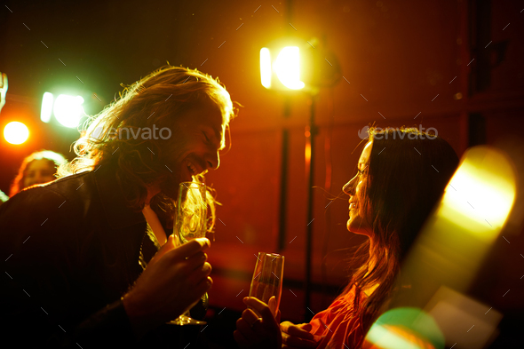 Man picking up girl at party - Stock Photo - Images