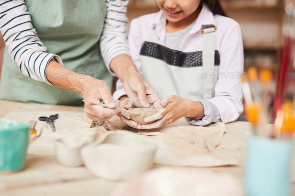 Little Girl Kneading Clay - Stock Photo - Images
