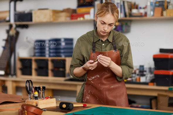 Female Tanner in Shop - Stock Photo - Images