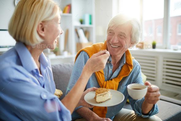 Loving Senior Couple Enjoying Coffee - Stock Photo - Images