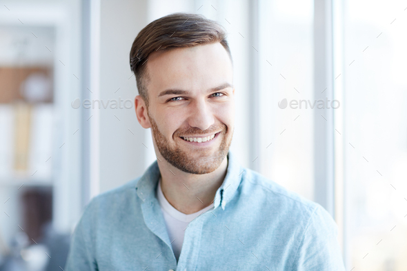 Portrait of Handsome Man by Window - Stock Photo - Images
