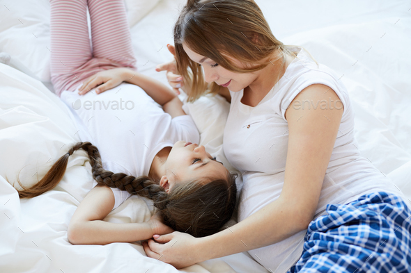 Pregnant Woman with Elder Daughter - Stock Photo - Images