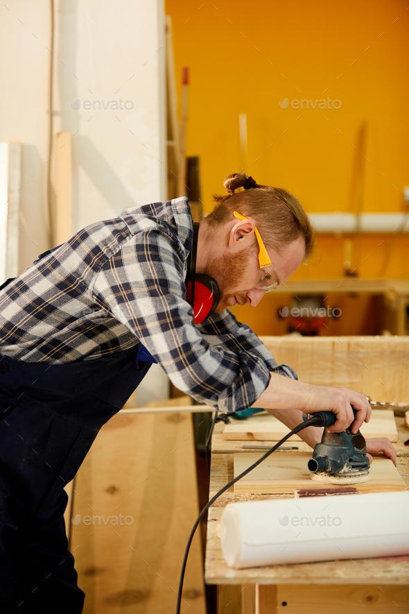 Contemporary Carpenter Polishing Wood - Stock Photo - Images