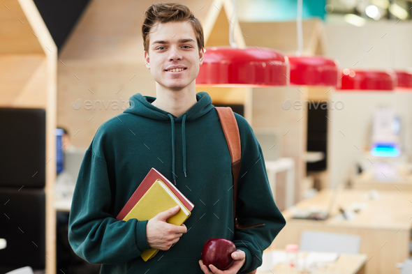 Positive young guy with workbooks - Stock Photo - Images