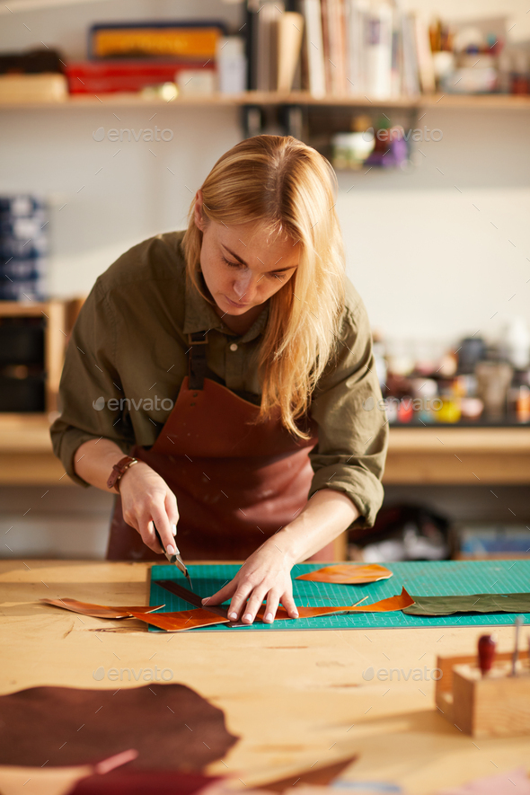 Tailor Working with Leather - Stock Photo - Images
