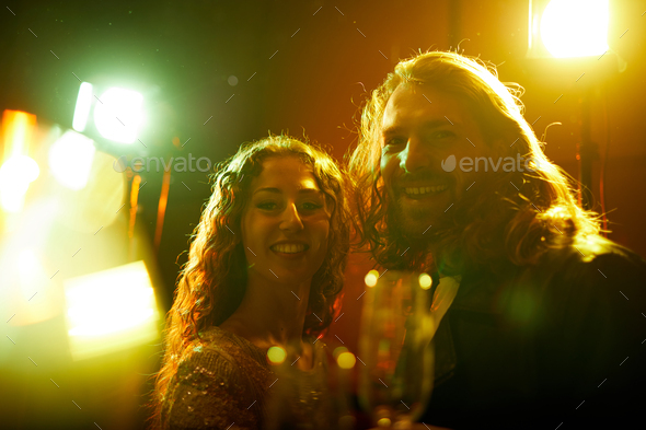 Jolly couple at party - Stock Photo - Images