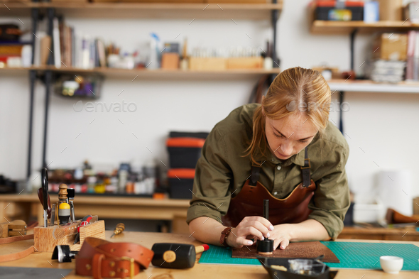Female Tanner Working - Stock Photo - Images