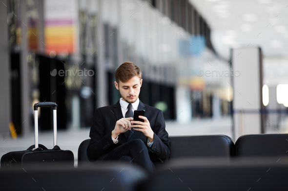 Businessman Waiting in Airport - Stock Photo - Images
