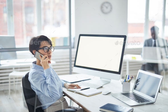 Talking to client on the phone - Stock Photo - Images