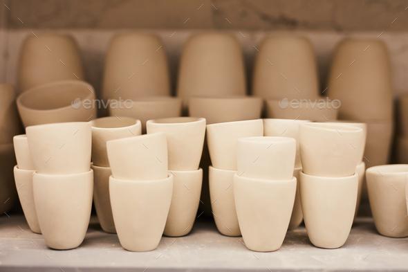 Ceramic mugs on shelf - Stock Photo - Images