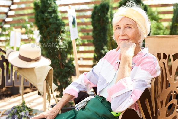 Senior Woman Resting in Garden - Stock Photo - Images