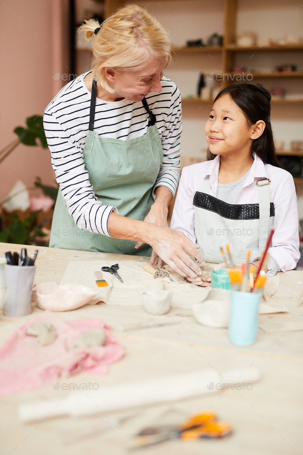 Art Teacher Helping Asian Girl - Stock Photo - Images