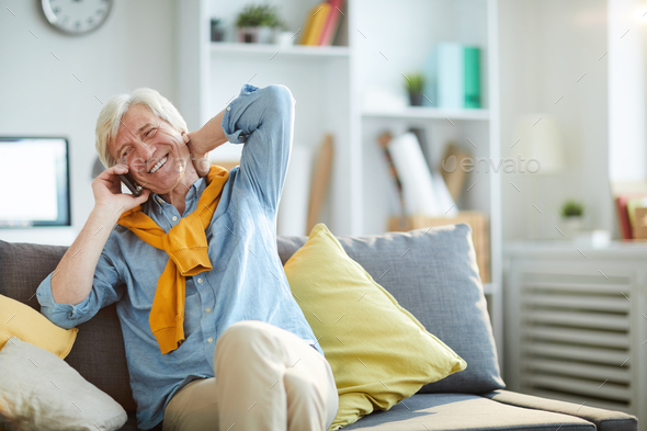 Cheerful Senior Man Speaking by Phone - Stock Photo - Images