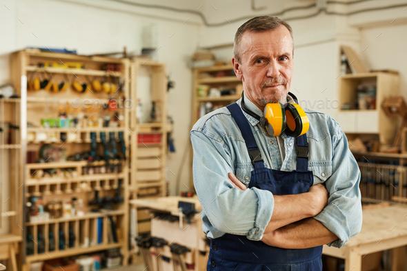 Senior Carpenter Posing in Workshop - Stock Photo - Images